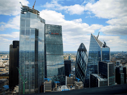 "Skyscraper office blocks, including Tower 42 (L), the Leadenhall Building, commonly called the ""Cheesegrater"" (C), 30 St Mary Axe commonly called the ""Gherkin"" (centre R), and 5254 Lime Street, commonly called the ""Scalpel"" (R) are pictured from inside the Sky Garden in London on July 3, 2019. (Photo by Tolga …"