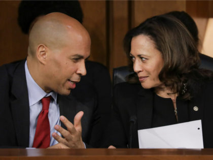 (L-R) Sen. Cory Booker (D-NJ) and Sen. Kamala Harris (D-CA) talk with each other as they listen to Supreme Court nominee Judge Brett Kavanaugh testify before the Senate Judiciary Committee on the third day of his Supreme Court confirmation hearing on Capitol Hill September 6, 2018 in Washington, DC. Kavanaugh …