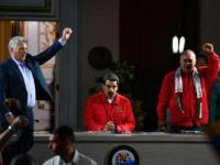 (L-R) Cuban President Miguel Diaz-Canel, his Venezuelan counterpart Nicolas Maduro and the president of the Venezuelan National Constituent Assembly Diosdado Cabello are pictured during the closing ceremony of the the Sao Paulo Forum at Miraflores Presidential Palace in Caracas on July 28, 2019. - Sao Paulo Forum is a conference …