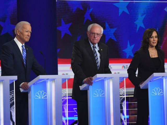 Democratic presidential hopefuls (fromL) former US Vice President Joseph R. Biden Jr., US Senator for Vermont Bernie Sanders and US Senator for California Kamala Harris speak during the second Democratic primary debate of the 2020 presidential campaign season hosted by NBC News at the Adrienne Arsht Center for the Performing …