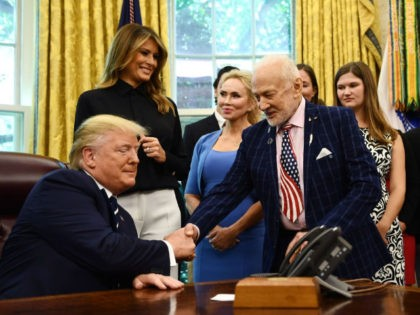 US President Donald Trump shakes hands with Apollo 11 crew member Buzz Aldrin on July 19, 2019, at the White House in Washington, DC, during a ceremony commemorating the 50th anniversary of the Moon landing. (Photo by Brendan Smialowski / AFP) (Photo credit should read BRENDAN SMIALOWSKI/AFP/Getty Images)