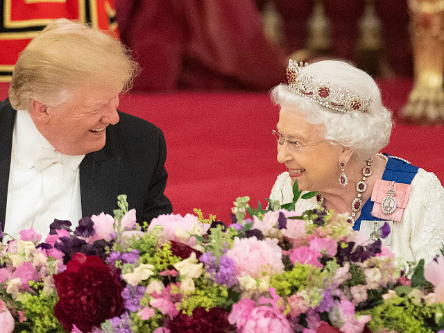 TOPSHOT - Britain's Queen Elizabeth II (R) laughs with US President Donald Trump during a State Banquet in the ballroom at Buckingham Palace in central London on June 3, 2019, on the first day of the US president and First Lady's three-day State Visit to the UK. - Britain rolled …