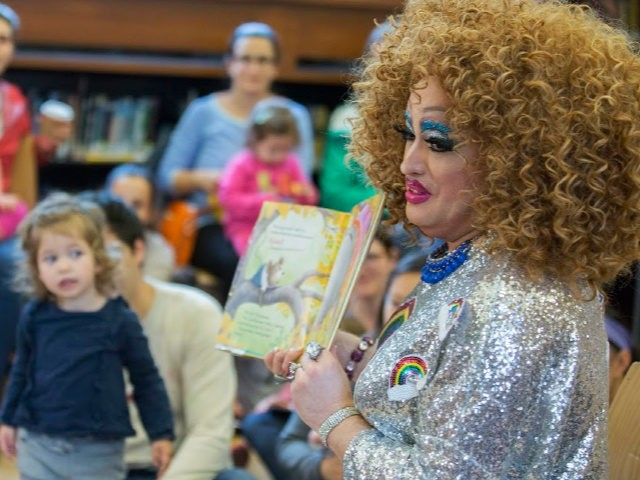 In this Saturday, May 13, 2017 photo, Lil Miss Hot Mess reads to children during the Feminist Press' presentation of Drag Queen Story Hour at the Park Slope Branch of the Brooklyn Public Library, in New York. About once a month since last fall, the Brooklyn Public Library has been …