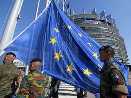 Soldiers of Eurocorps raise an European Union flag during the flag-raising ceremony on the eve of the inaugural session of new European Parliament on July 1, 2019 in front of Louise Weiss building (R), headquarters of the European Parliament in Strasbourg, eastern France. (Photo by FREDERICK FLORIN / AFP) (Photo …