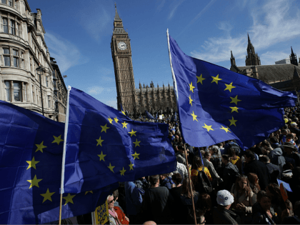 Demonstrators holding EU flags gather in Parliament Square following an anti Brexit, pro-European Union (EU) march in London on March 25, 2017, ahead of the British government's planned triggering of Article 50 next week. Britain will launch the process of leaving the European Union on March 29, setting a historic …