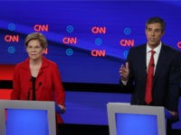 Democratic presidential candidate former Texas congressman Beto O'Rourke (R) speaks while Sen. Elizabeth Warren (D-MA) listens during the Democratic Presidential Debate at the Fox Theatre July 30, 2019 in Detroit, Michigan. 20 Democratic presidential candidates were split into two groups of 10 to take part in the debate sponsored by …