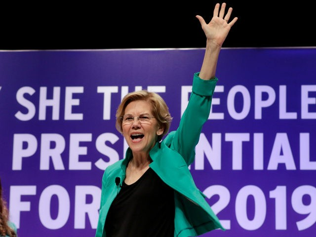 Democratic presidential candidate Sen. Elizabeth Warren, D-Mass., waves to the audience before taking questions during a presidential forum held by She The People on the Texas State University campus Wednesday, April 24, 2019, in Houston. (AP Photo/Michael Wyke)