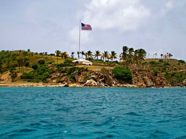 This Tuesday, July 9, 2019 photo shows a view of Little St. James Island, in the U. S. Virgin Islands, a property owned by Jeffrey Epstein. The 66-year-old billionaire bought the island more than two decades ago and began to transform it, clearing the native vegetation, ringing the property with towering palm trees and planting two massive U.S. flags on either end. (AP Photo/Gianfranco Gaglione)