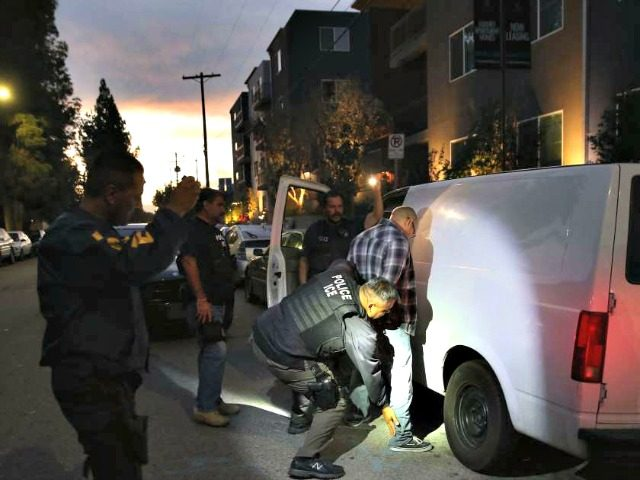 In this file photo from 2015, a man is detained by Immigration and Customs Enforcement agents in Los Angeles. New raids could target a large number of immigrants in major cities.