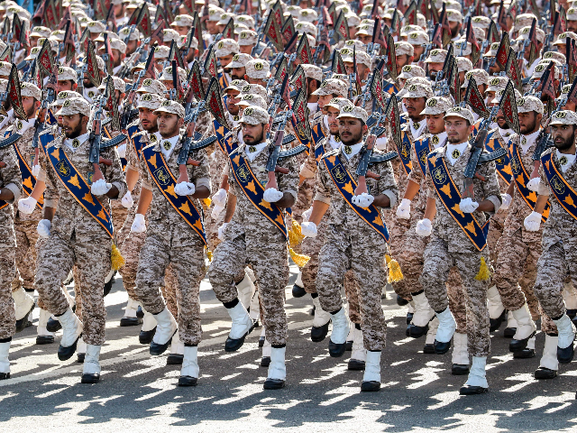 Members of Iran's Revolutionary Guards Corps (IRGC) march during the annual military parade marking the anniversary of the outbreak of the devastating 1980-1988 war with Saddam Hussein's Iraq, in the capital Tehran on September 22, 2018. - In Iran's southwestern city of Ahvaz during commemoration of the same event, dozens …