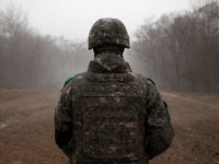 In a photo taken on December 3, 2018 a South Korean soldier stands before the Military Demarcation Line (MDL) separating North and South Korea, on the southern side of the Demilitarized Zone (DMZ) in South Korea's Cheorwon county. - North and South Korea have connected a road across their shared …