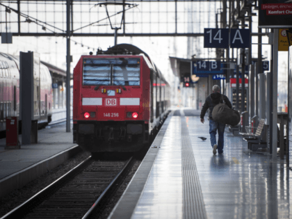 FRANKFURT, GERMANY - DECEMBER 10: A passenger walks to a regional train after a strike by Deutsche Bahn workers at central station on December 10, 2018 in Frankfurt/Main, Germany. The strike, launched by the EVG labor union, shut down Deutsche Bahn's S-Bahn and Regio commuter rail services as well as …