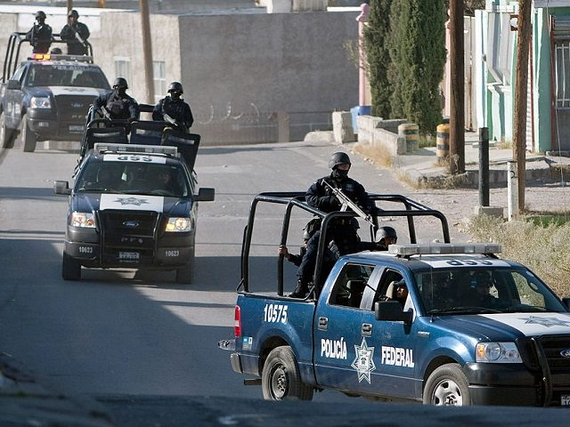 Mexican federal police arrive at crime scene. (File Photo: Jesus Alcazar/AFP/Getty Images)