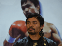 Philippine boxing icon Manny Pacquiao listens to a question during a press conference shortly after arriving at the international airport in Manila on January 24, 2019, days after defeating US boxer Adrien Broner in Las Vegas. (Photo by TED ALJIBE / AFP) (Photo credit should read TED ALJIBE/AFP/Getty Images)