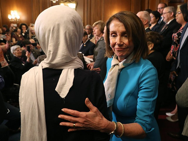 WASHINGTON, DC - MARCH 13: House Speaker Nancy Pelosi (D-CA) walks by Rep. Ilhan Omar (D-MN) (L) during a news conference where House and Senate Democrats introduced the Equality Act of 2019 which would ban discrimination against lesbian, gay, bisexual and transgender people, on March 13, 2019 in Washington, DC. …