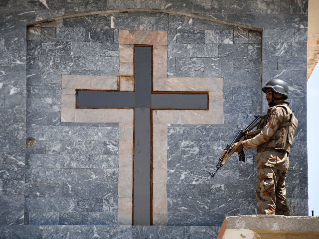 A Pakistani soldier stands guard on the roof of a Methodist Church during the Easter service in Quetta on April 21, 2019. - A series of eight devastating bomb blasts ripped through high-end hotels and churches holding Easter services in Sri Lanka on April 21, killing nearly 160 people, including …