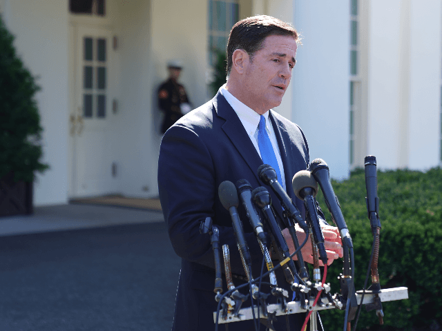 "Arizona Governor Doug Ducey talks to reporters after meeting with President Donald Trump at the White House April 03, 2019 in Washington, DC. Ducey said he spoke with Trump about security along the Arizona-Mexico border and called on Congress to ""stop playing political games and act."" (Photo by Chip Somodevilla/Getty …"