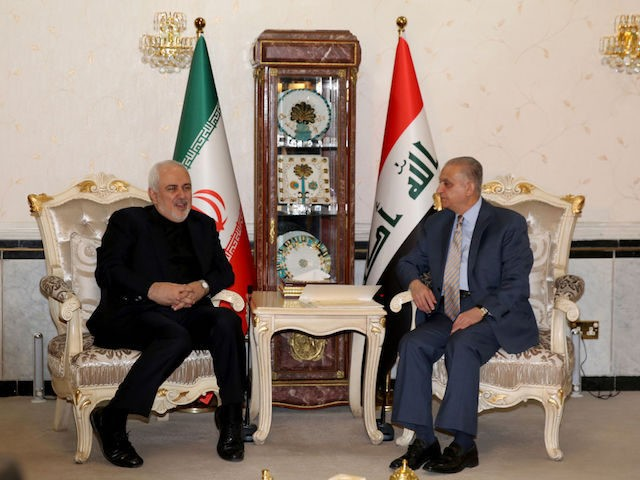 Iraqi Foreign Minister Mohammad Ali al-Hakim (R) meets Iran's Foreign Minister Mohammad Javad Zarif in Baghdad on May 26, 2019. (Photo by SABAH ARAR / AFP) (Photo credit should read SABAH ARAR/AFP/Getty Images)
