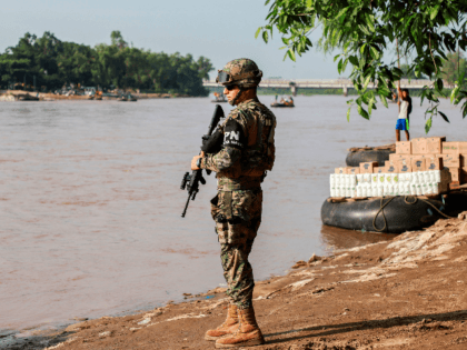 A naval police officer patrols the banks of the Suchiate river in Ciudad Hidalgo, Chiapas State, Mexico, to prevent illegal crossings across the border river to and from Tecun Uman in Guatemala, on June 17, 2019. (Photo by QUETZALLI BLANCO / AFP) (Photo credit should read QUETZALLI BLANCO/AFP/Getty Images)