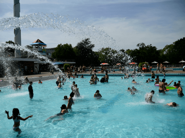 Visitors swim in a swimming pool in Essen, western Germany, on June 25, 2019, as temperatures topped 36 degrees Celsius. - Europeans are set to bake in what forecasters are warning will likely be record-breaking temperatures for June with the mercury set to hit 40 degrees Celsius (104 degrees Fahrenheit) …