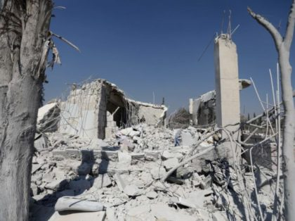 The ruins of buildings are pictured on July 1, 2019 at the site where the US military carried out a strike against Al-Qaeda-linked jihadists in Syria's northwestern Aleppo province. - The US military said today it had targeted jihadists in an embattled northwestern opposition bastion in northwest Syria the previous …