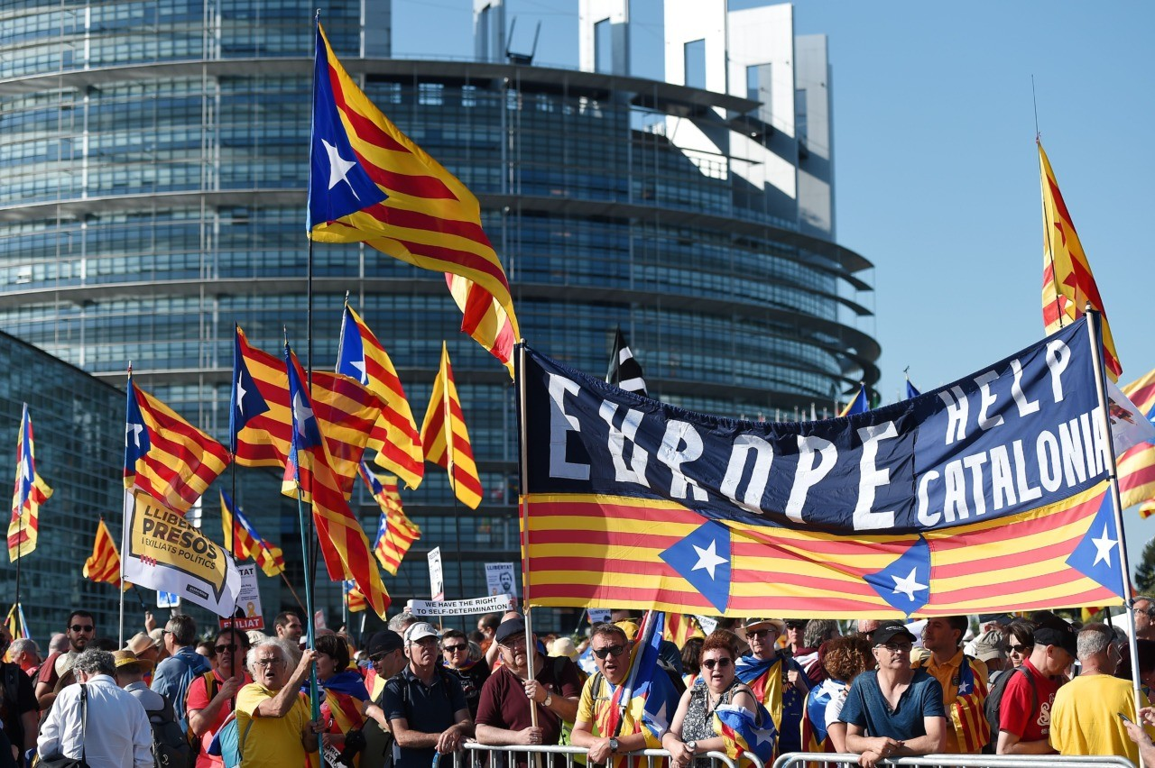 People wave Catalan pro-independence 'Estelada' flags and banners during a demonstration in front of the European Parliament on July 2 , 2019 in Strasbourg, eastern France. - Demonstrators protest in support of Catalan separatists unable to take seats as MEPs. (Photo by FREDERICK FLORIN / AFP) (Photo credit should read FREDERICK FLORIN/AFP/Getty Images)
