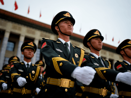 Chinese honour guards prepare for the arrival of Turkish President Recep Tayyip Erdogan and Chinese President Xi Jinping during a welcome ceremony outside the Great Hall of the People in Beijing on July 2, 2019. (Photo by WANG ZHAO / AFP) (Photo credit should read WANG ZHAO/AFP/Getty Images)