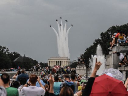"""WASHINGTON, DC - JULY 04: People react to a military fly over on the National Mall while President Donald Trump gives his speech during Fourth of July festivities on July 4, 2019 in Washington, DC. President Trump is holding a """"Salute to America"""" celebration on the National Mall on Independence …"""