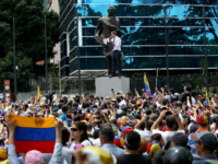 Opposition leader and president of the National Assembly Juan Guaido speaks to supporters during a demonstration at PNUD as part of the 208th anniversary of the Venezuelan Independence declaration on July 5, 2019 in Caracas, Venezuela. Venezuelan opposition leader Juan Guaidó and several NGO called for a demonstration after the …