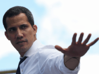 Opposition leader and president of the National Assembly Juan Guaido greets supporters during a demonstration at PNUD as part of the 208th anniversary of the Venezuelan Independence declaration on July 5, 2019 in Caracas, Venezuela. Venezuelan opposition leader Juan Guaido and several NGO called for a demonstration after the death …
