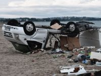 TOPSHOT - A caravan overturned by strong winds lies on a beach where a storm killed a Czech couple in Nea Plagia, in Chalkidiki, Northern Greece, on July 11, 2019. - Tornadoes and violent hailstorms killed six tourists in northern Greece late on July 10, 2019, police said. Dozens more …