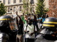 French police officers stand as undocumented migrants demonstrate to ask for the regularisation of their situation near the Pantheon in Paris, on July 12, 2019. (Photo by Kenzo TRIBOUILLARD / AFP) (Photo credit should read KENZO TRIBOUILLARD/AFP/Getty Images)
