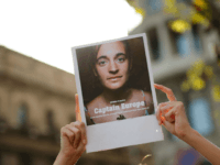 A protester holds a picture of migrant rescue ship Sea Watch captain Carola Rackete during a demonstration in Barcelona called by Spanish non-governmental organisation Proactiva Open Arms against the criminalisation of migrant rescue missions on July 13, 2019. - German national Rackete, 31, was arrested after defying a blockade imposed …