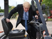 Conservative MP and leadership contender Boris Johnson drives a forklift truck during a leadership campaign visit to a nursery in Braintree, southeast England on July 13, 2019. - Britain's leadership contest is taking the two contenders on a month-long nationwide tour where they will each attempt to reach out to …