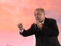 Turkey president Recep Tayyip Erdogan speaks during a third anniversary commemoration rally at the Ataturk International Airport in Istanbul on July 15, 2019. - Turkey commemorates, on July 15, 2019 the third anniversary of a coup attempt which was followed by a series of purges in the public sector and …