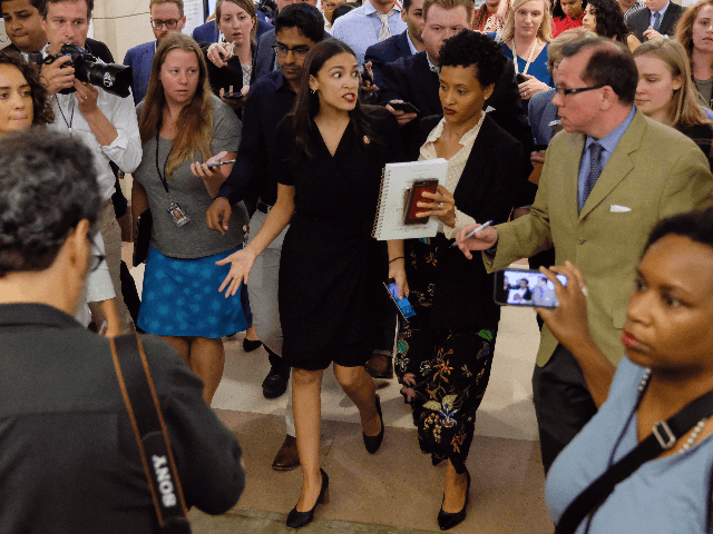 "U.S. Rep Alexandria Ocasio-Cortez (D-NY) answers questions after a press conference at the U.S. Capitol on July 15, 2019 in Washington, DC. President Donald Trump stepped up his attacks on four progressive Democratic congresswomen, saying if they're not happy in the United States ""they can leave."" (Photo by Alex Wroblewski/Getty …"