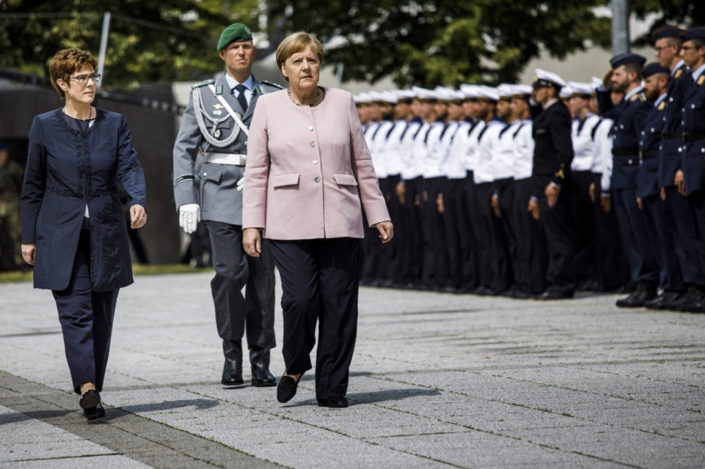 BERLIN, GERMANY - JULY 20: German Chancellor Angela Merkel (R), and German Defence Minister Annegret Kramp-Karrenbauer (L), walks beside the recruits during an oath-taking ceremony of the German army at the Defence Ministryon July 20, 2019 in Berlin, Germany. The pledge takes place in memory of the resistance against the National Socialist dictatorship on the occasion of the 75th anniversary of the failed attack on Adolf Hitler on July 20, 1944. (Photo by Carsten Koall/Getty Images)