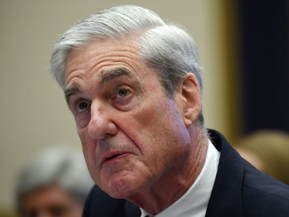 Former Special Prosecutor Robert Mueller testifies before Congress on July 24, 2019, in Washington, DC. - Mueller told US lawmakers Wednesday that his report on Russia election interference does not exonerate US President Donald Trump, as the president has repeatedly asserted. (Photo by Andrew CABALLERO-REYNOLDS / AFP) (Photo credit should …