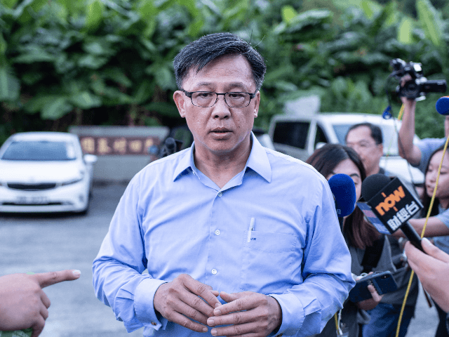 This picture taken on July 23, 2019 shows Hong Kong pro-Beijing government lawmaker Junius Ho leaving the cemetery after learning his parents' gravestones were vandalised in the Tuen Mun district of Hong Kong. - Hong Kong police on July 25 banned a planned protest against suspected triad gangs who beat …