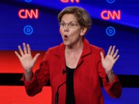 Democratic presidential hopeful US Senator from Massachusetts Elizabeth Warren gestures as she speaks during the first round of the second Democratic primary debate of the 2020 presidential campaign season hosted by CNN at the Fox Theatre in Detroit, Michigan on July 30, 2019. (Photo by Brendan Smialowski / AFP) (Photo …