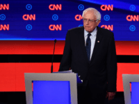 Democratic presidential hopeful US senator from Vermont Bernie Sanders looks on during a break in the first round of the second Democratic primary debate of the 2020 presidential campaign season hosted by CNN at the Fox Theatre in Detroit, Michigan on July 30, 2019. (Photo by Brendan Smialowski / AFP) …