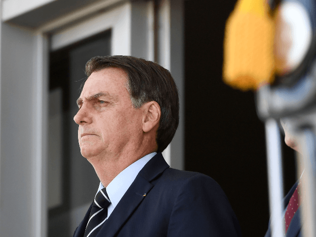 Brazilian President Jair Bolsonaro attends the changing of the guard ceremony at Planalto Palace in Brasilia, on July 31, 2019. - Bolsonaro met with US Secretary of Commerce Wilbur Ross Wednesday in Brasilia. (Photo by EVARISTO SA / AFP) (Photo credit should read EVARISTO SA/AFP/Getty Images)