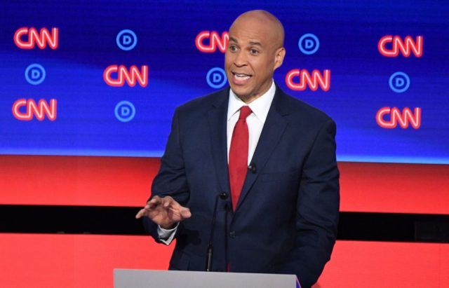 Democratic presidential hopeful US Senator from New Jersey Cory Booker delivers his opening statement during the second round of the second Democratic primary debate of the 2020 presidential campaign season hosted by CNN at the Fox Theatre in Detroit, Michigan on July 31, 2019. (Photo by Jim WATSON / AFP) …