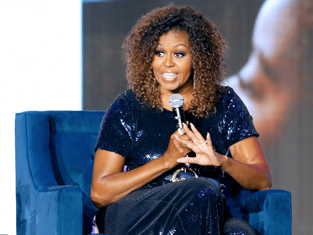 Michelle Obama speaks onstage during the 2019 ESSENCE Festival Presented By Coca-Cola at Louisiana Superdome on July 06, 2019 in New Orleans, Louisiana. (Photo by Bennett Raglin/Getty Images for ESSENCE)