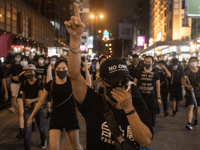 HONG KONG, HONG KONG - JULY 07: Protesters march towards the Mong Kok district after attending a demonstration at West Kowloon railway station protesting against the proposed extradition bill on July 7, 2019. in Hong Kong, China. Thousands of protesters marched to the train station which links Hong Kong to …
