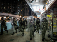 Riot police chase protesters through a shopping mall as they clash with protesters after taking part in a pro-democracy march on July 14, 2019 in Hong Kong, China. Thousands of protesters marched in Sha Tin district on Sunday as pro-democracy demonstrators continued weekly rallies on the streets of Hong Kong …