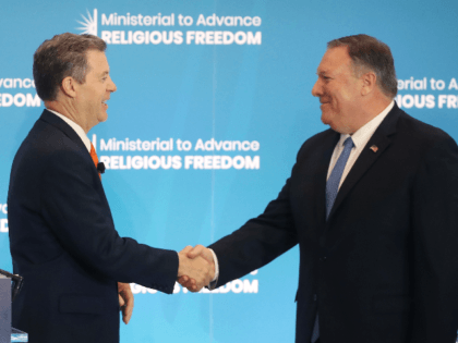 (L-R) Ambassador at Large for International Religious Freedom, Sam Brownback, introduces U.S. Secretary of State Mike Pompeo to deliver opening remarks at the second Ministerial to Advance Religious Freedom, at the Department of State, July 16, 2019 in Washington, DC. (Photo by Mark Wilson/Getty Images)