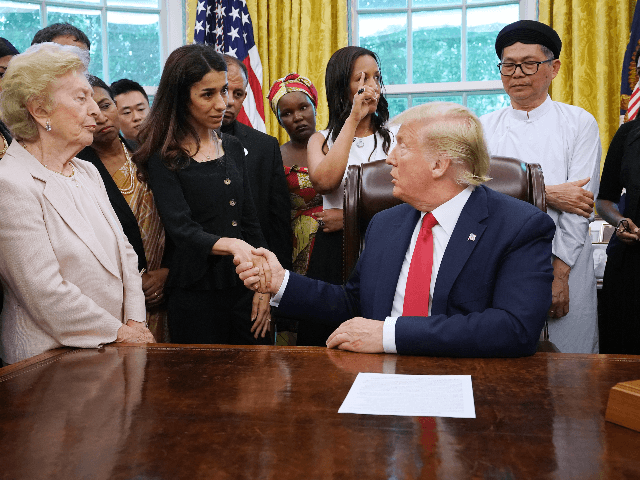 U.S. President Donald Trump shakes hands with Iraqi Yazidi human rights activist and Nobel Peace Prize winner Nadia Murad of Iraq while he hosts her and other survivors of religious persecution from 17 countries around the world in the Oval Office at the White House July 17, 2019 in Washington, …