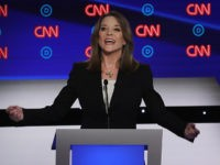 DETROIT, MICHIGAN - JULY 30: Democratic presidential candidate Marianne Williamson speaks while Rep. Tim Ryan (D-OH) listens during the Democratic Presidential Debate at the Fox Theatre July 30, 2019 in Detroit, Michigan. 20 Democratic presidential candidates were split into two groups of 10 to take part in the debate sponsored …