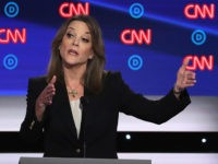 DETROIT, MICHIGAN - JULY 30: Democratic presidential candidate Marianne Williamson speaks during the Democratic Presidential Debate at the Fox Theatre July 30, 2019 in Detroit, Michigan. 20 Democratic presidential candidates were split into two groups of 10 to take part in the debate sponsored by CNN held over two nights …